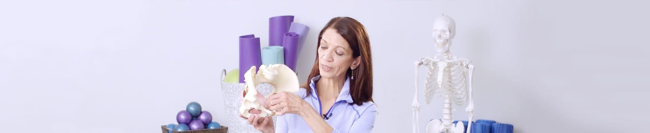 Carolyne Anthony explaining the anatomy of a female pelvis during the Pelvic Floor health course